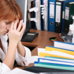 A woman has migraine in office
